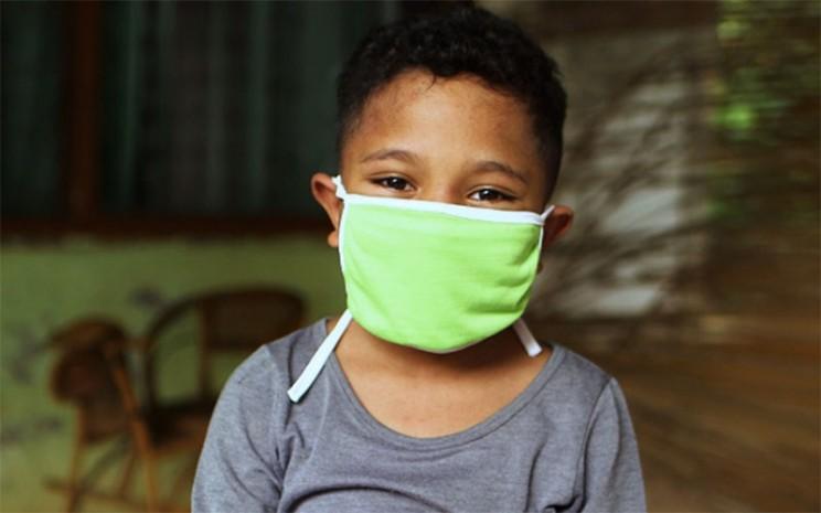Ilustrasi penggunaan masker. - UNICEF