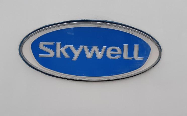 Logo Skywell. Skywell, yang didirikan pada 2011, merupakan manufaktur dan penjual bus besar, sedang, ringan, serta mobil penumpang hingga komponen dan suku cadang.  - Bisnis.com/Dion