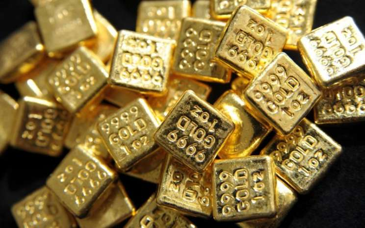 Emas batangan 24 karat ukuran 1oz atau 1 ons, setara 28,34 gram. Harga emas terdorong stimulus ekonomi AS. - Bloomberg