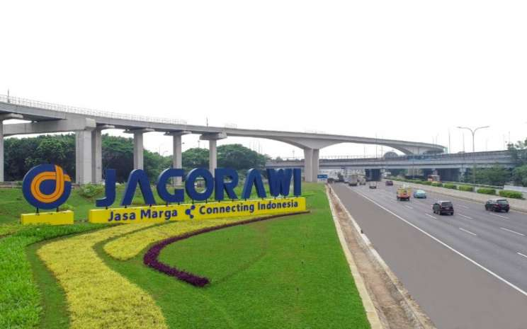 Tengara Jagorawi di salah satu titik ruas jalan tol Jakarta-Bogor-Ciawi. Jalan tol Jagorawi merupakan jalan tol pertama yang dikelola oleh PT Jasa Marga (Persero) Tbk. - Jasa Marga