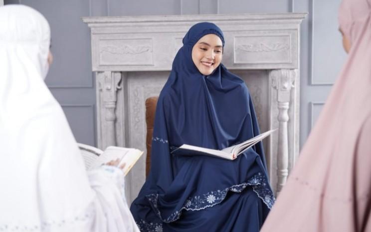 Mukena Siti Khadijah berasal dari Malaysia dan telah memiliki 4 gerai di Indonesia. - istimewa