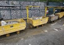 Mobil tambang yang mengangkut bijih batu muncul dari terowongan di tambang emas PT Aneka Tambang Tbk. (ANTM) di Pongkor, Jawa Barat, Indonesia, pada Kamis 7 November 2013./Bloomberg-Dadang Tri