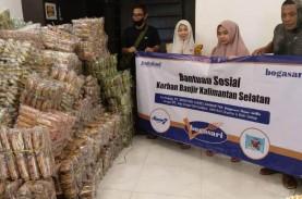 Bogasari Bagi 20.000 Roti untuk Korban Banjir Kalsel