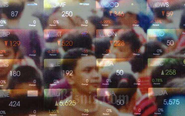 Foto multiple exposure layar pergerakan Indeks Harga Saham Gabungan (IHSG) di Galeri Bursa Efek Indonesia, Jakarta, Rabu (18/3/2020). Bisnis - Himawan L Nugraha