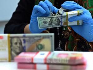 Nilai Tukar Rupiah di Pasar Spot Menguat 0,11 Persen Menjadi Rp14.050 Per Dolar AS