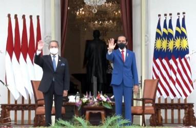 Tamu Negara Pertama 2021, Jokowi Sambut PM Muhyiddin di Istana Merdeka