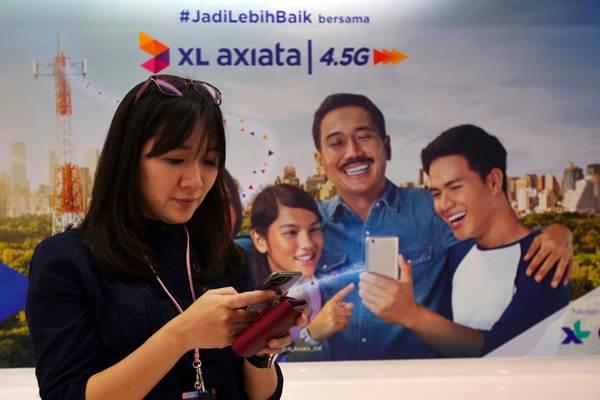 Pelanggan berada di XL Center, Jakarta, Kamis (21/6/2018). - JIBI/Abdullah Azzam