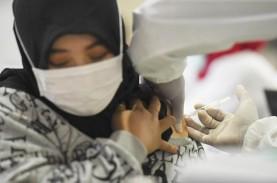 Foto-Foto Vaksinasi Covid-19 di Pasar Tanah Abang