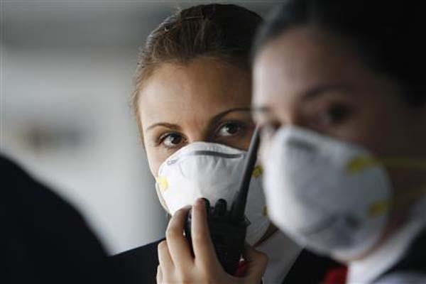 Ilustrasi pemakaian masker untuk menghindari penyebaran virus