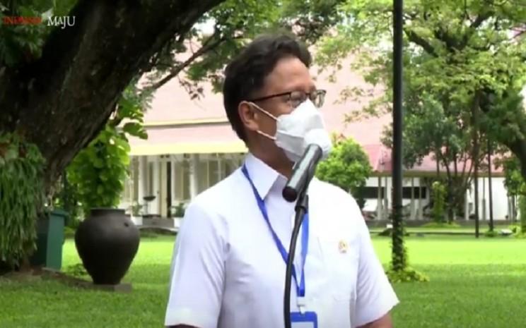 Menteri Kesehatan Budi Gunadi Sadikin usai menjalani vaksinasi CoronaVac kedua di Istana Negara, Rabu (27/1/2021). JIB - Bisnis/Nancy Junita