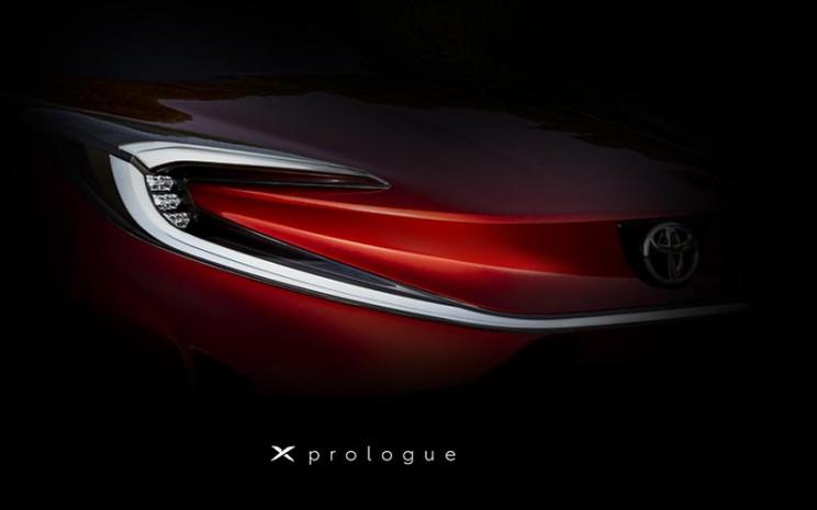 Toyota memberikan sedikit bocoran garis desain mobil listrik anyar yang diberi nama Toyota X Prologue.  - Toyota