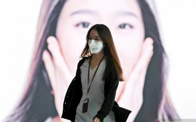 penggunaan masker kain semakin populer dengan berbagai variasi model, bahan, dan warna.  - ANtara