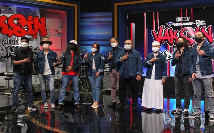 """Berkolaborasi dengan Media Group, grup band Slank baru saja meresmikan kampanye """"Vaksin untuk Indonesia"""" yang disampaikan melalui sebuah hiburan inspiratif, Senin (29 - 3)."""