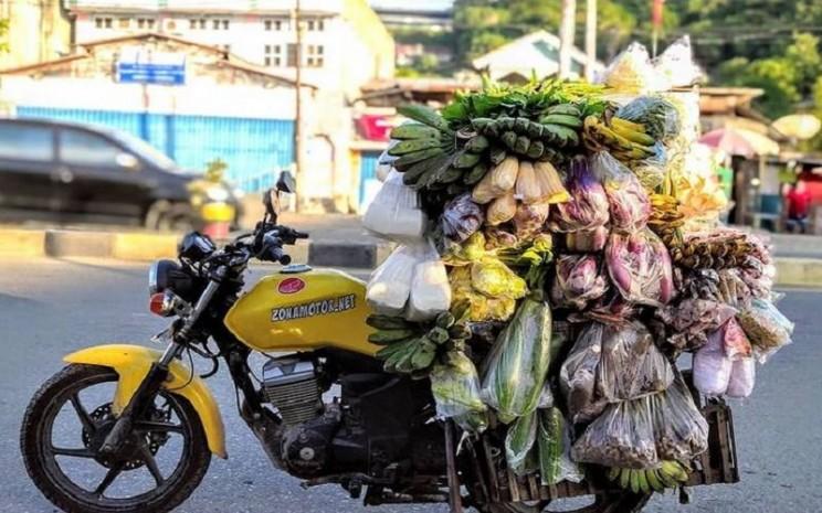 Pedagang sayur keliling di Papua. - Instagram @mas_sayur