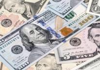 Uang kertas dolar AS./Bloomberg-Paul Yeung