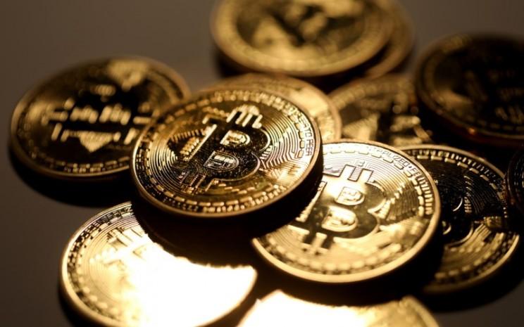 Ilustrasi Bitcoin. - Bloomberg