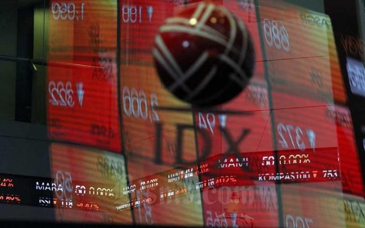 Papan elektronik menampilkan perdagangan harga saham di Jakarta, Senin (23/3/2020). Bisnis - Dedi Gunawan