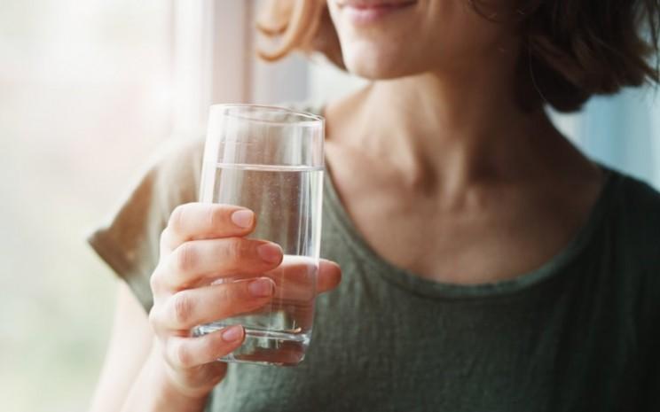 Ilustrasi orang minum air - istimewa