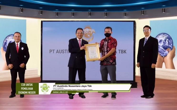 Foto: Bapak Arianto Wibowo (Head of Cooperative  Sustainability ANJ) pada saat menerima The Gold Champion pada BISRA Award 2021
