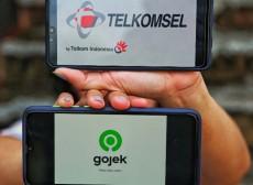 Kilau Cahaya Kuning di Investasi Telkomsel ke Gojek. Hati-hati atau Ngebut?
