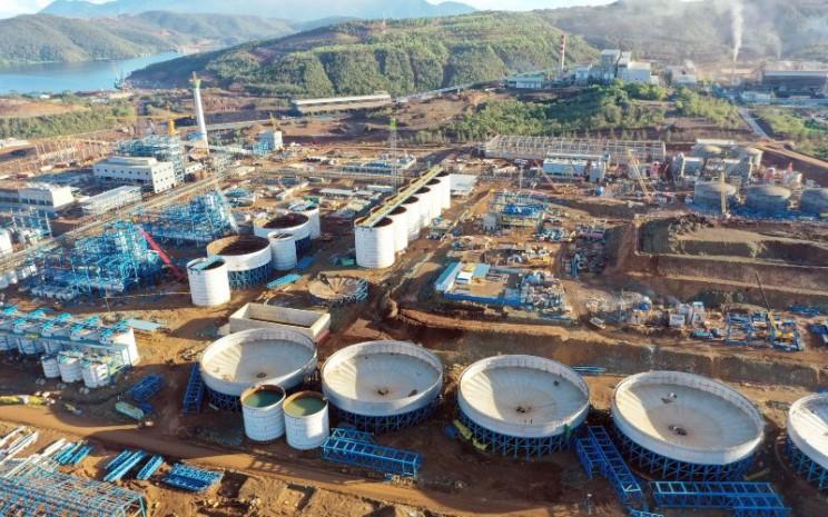 Pabrik bahan baku baterai mobil listrik yang dibangun oleh Harita Nickel di Kawasi, Obi, Halmahera Selatan sudah memasuki tahap konstruksi akhir.  - Harita Nickel