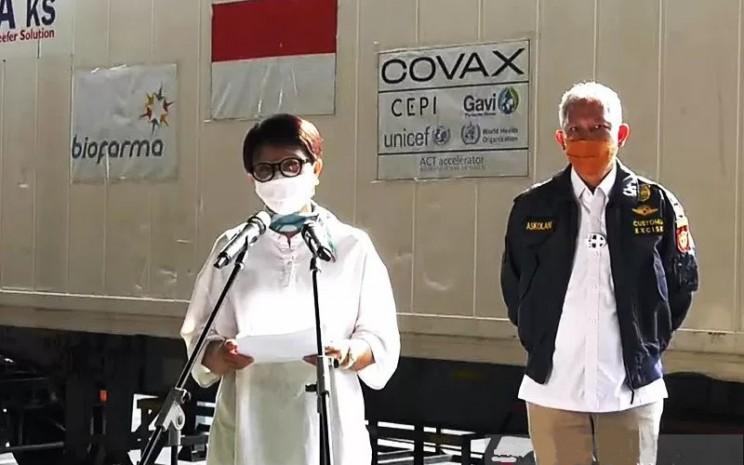 Menteri Luar Negeri Retno Marsudi memberikan keterangan pers secara virtual terkait ketibaan batch ketiga vaksin AstraZeneca dari Covax Facility, Kamis (10/6/2021).  - ANTARA/Rangga Pandu Asmara Jingga