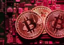 Ilustrasi tumpukan Bitcoin./Bloomberg-Chris Ratcliffe