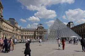 Prancis Cabut Aturan Wajib Pakai Masker dan Jam Malam